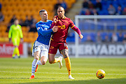 Charles Dunne (#18) of Motherwell FC uses his shoulder to keep Michael O'Halloran (#17) of St Johnstone FC away from the ball during the Ladbrokes Scottish Premiership match between St Johnstone and Motherwell at McDiarmid Stadium, Perth, Scotland on 11 May 2019.