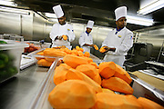 Chefs peels sweet potatoes for the never-ending dinner  onboard the cruise ship Oasis of the Seas. The ship, currently the largest in the world, is owned by Royal Carribean Cruise Line.