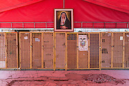 2016/08/04 – Portoviejo, Ecuador: The locker room on the fireman headquarters in Portoviejo, Ecuador, with a portrait of the Lady of the Sorrows, 4th August 2016. The fireman headquarters collapsed during the 16th April earthquake and they now operate under tents until a new headquarters is build. (Eduardo Leal)