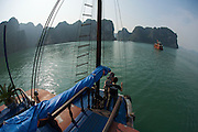 Halong Bay. Tourist boats with dragon's head at the bow gliding through the 3.000 limestone islands of the bay. Nicole Schmidt.