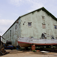 An abondoned building and commercial fishing bunker (menhaden) on the docks of the Belford Seasfood Co-operative fishing fleet in Belford New Jersey.