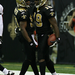 2007 December, 2: New Orleans Saints wide receiver Devery Henderson (19) celebrates a touchdown catch with teammate David Patten (81) during a 27-23 win by the Tampa Bay Buccaneers over the New Orleans Saints at the Louisiana Superdome in New Orleans, LA.