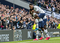 Football - 2019 / 2020 Premier League - Tottenham Hotspur vs. Wolverhampton Wanderers<br /> <br /> Sreven Bergwijn (Tottenham FC)  scorer of the opening goal leaps onto the back of Serge Aurier (Tottenham FC)  after he gives his team a 2-1 lead at The Tottenham Hotspur Stadium.<br /> <br /> COLORSPORT/DANIEL BEARHAM