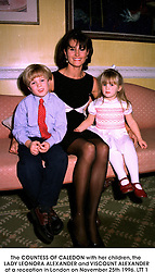 The COUNTESS OF CALEDON with her children, the LADY.LEONORA ALEXANDER and VISCOUNT ALEXANDER at a reception in London on November 25th 1996.LTT 1