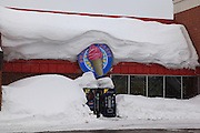 Even the local ice cream parlor in Calumet, Michigan, appears to be inundated with snow. I'd hate to be standing in front of those soda machines when those couple tons of snow decide to come down.