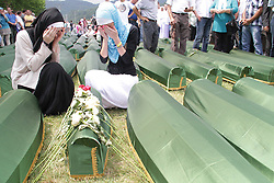 60113382  <br /> Two women mourn next to a small coffin in Srebrenica, Bosnia and Herzegovina, July 11, 2013. Thousands of in Bosnia and Herzegovina gathered on Thursday at Potocari Memorial Centre near Srebrenica to mourn for victims in the 1995 Srebrenica Massacre. A total of 409 newly-identified victims were buried at the centre on the 18th anniversary of the massacre, putting the numbers of gravestones to over 6000, picture taken Thursday, July 11, 2013.<br /> Photo by imago / i-Images<br /> UK ONLY