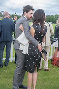 Jack Whitehall; Gemma Chan, Cartier Queen's Cup. Guards Polo Club, Windsor Great Park. 17 June 2012