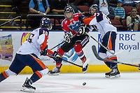 KELOWNA, CANADA - AUGUST 30:  Nathan Looysen #37 of the Kamloops Blazers checks Braydyn Chizen #27 of the Kelowna Rockets on August 30, 2014 during pre-season at Prospera Place in Kelowna, British Columbia, Canada.   (Photo by Marissa Baecker/Shoot the Breeze)  *** Local Caption *** Nathan Looysen; Braydyn Chizen;