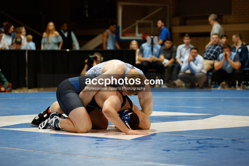 2017 February 08: Duke Blue Devils wrestling during a 25-15 loss to the the North Carolina Tar Heels at Card Gymnasium in Durham, NC.<br /> <br /> 197: Daniel Chaid (UNC) fall Luke Farinaro (Duke), 4:56
