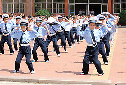 June 20, 2017 - Rongchen, Rongchen, China - Rongcheng, CHINA-June 20 2017: (EDITORIAL USE ONLY. CHINA OUT) Pupils learn traffic commanding postures of traffic police at a primary school in Rongcheng, east China's Shandong Province, June 20th, 2017. (Credit Image: © SIPA Asia via ZUMA Wire)
