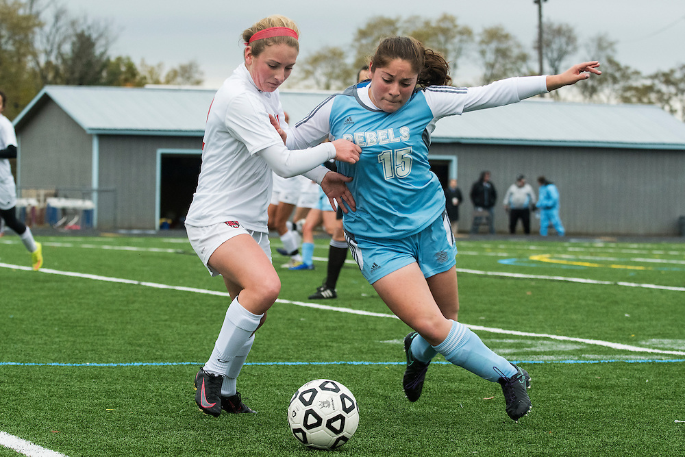 CVU's Hannah Munn (12) and South Burlington's Megan Harton (15) battle for the ball during the girls high school playoff game between the Champlain Valley Union Redhawks and the South Burlington Rebels at South Burlington High School on Saturday afternoon October 29, 2016 in South Burlington. (BRIAN JENKINS/for the FREE PRESS)