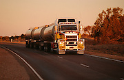 A Road Train on Stuart Highway at sunset.