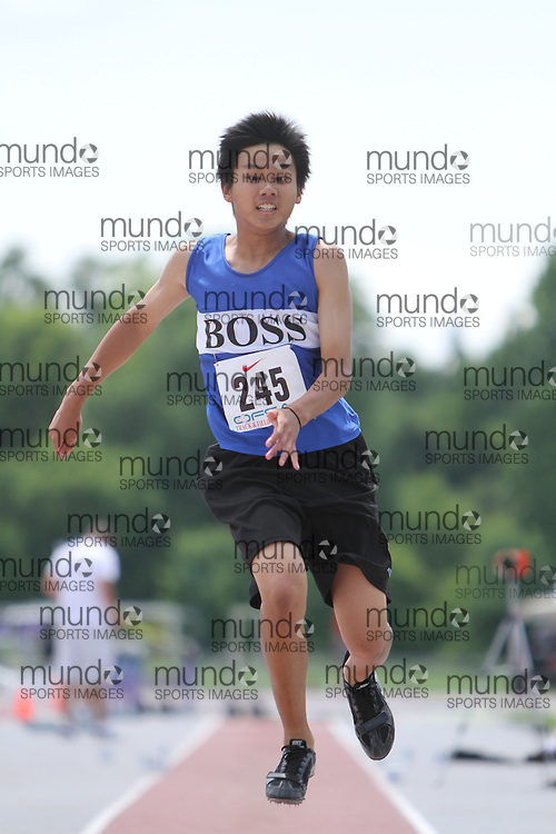 (London, Ontario}---05 June 2010) Rodney Lo of Bur Oak S S - yrbo competing in the midget boys triple jump at the 2010 OFSAA Ontario High School Track and Field Championships in London, Ontario, June 05, 2010 . Photograph copyright Laura Barclay / Mundo Sport Images, 2010.