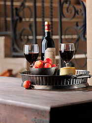 wine with glass and cheese with metal tray.