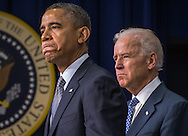 U.S. President Barack Obama and Vice President Joe Biden speak during a press conference at the White House to unveil a package of proposals to reduce gun violence January 16, 2013 in Washington D.C.  Photo Ken Cedeno.
