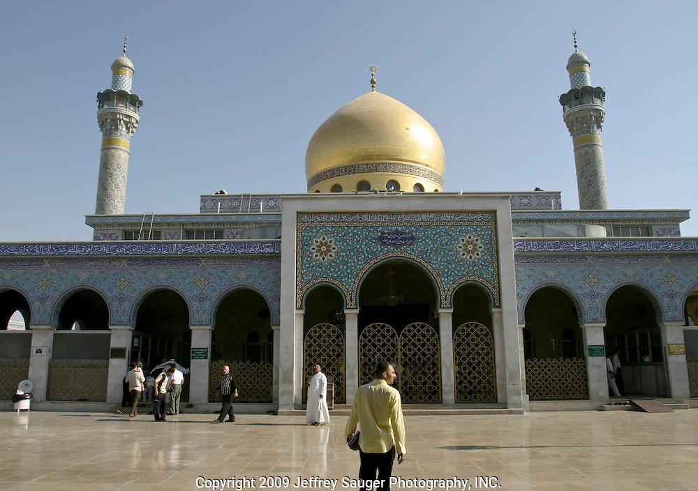 Emad Al-kasid approaches the Shrine of Sayidda Zeinab in the Iraqi area of Damascus, Syria, Friday, July 11, 2003. Emad Al-kasid, of Dearborn, MI, has been planning a trip home to Nasiriyah, Iraq, for over the last year. His first stop is Damascus visiting his immediate family as hundreds of thousands of Iraqi Shiite settled in Syria after the Gulf War and their uprising against Saddam Hussein in 1991.