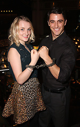 Harry Potter Star, Luna Lovegood, <br /> In the image -  Evanna Lynch and Jamie Nichols.<br /> Actress, Evanna Lynch with another Harry today, Harry Houdini, Actor, Jamie Nichols, at the unveiling of a plaque to Houdini, at the Hippodrome, London, Seen Trying To Escape From The Original Handcuffs Used By Harry Houdini At His Show At The Hippodrome, London, In 1904, London, United Kingdom. Thursday, 3rd October 2013. Picture by i-Images