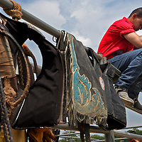 Gilberto Barros, 25, of Rockland, prays before competing in the Barretos na America rodeo at the Brockton Fairgrounds, Sunday,  May 24, 2009.