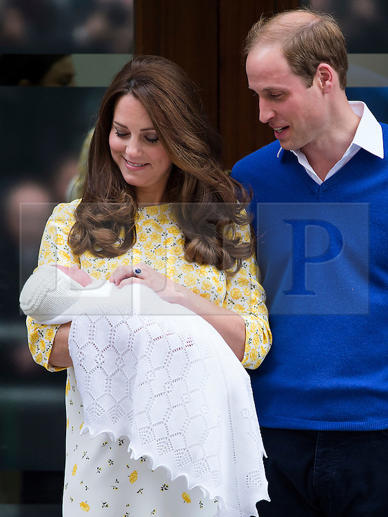 © London News Pictures. 02/05/2015. Catherine Duchess of Cambridge and Prince William leave the Lindo Wing of St Mary's hospital in London holding their new born baby daughter, Princess of Cambridge. Photo credit: Ben Cawthra/LNP /LNP