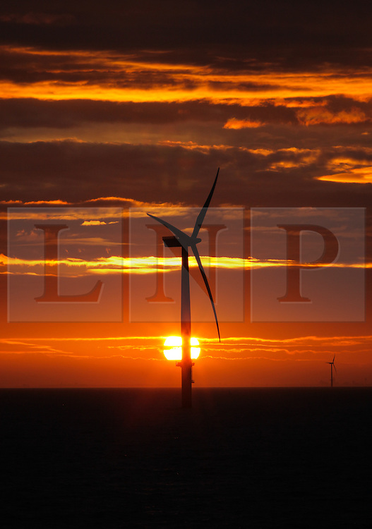 © Licensed to London News Pictures. 18/03/2014. Hampshire, UK. Sunrise over the Gwynt y Mor Offshore Wind Farm in North Wales this morning, 18th March 2014. Photo credit : Rob Arnold/LNP