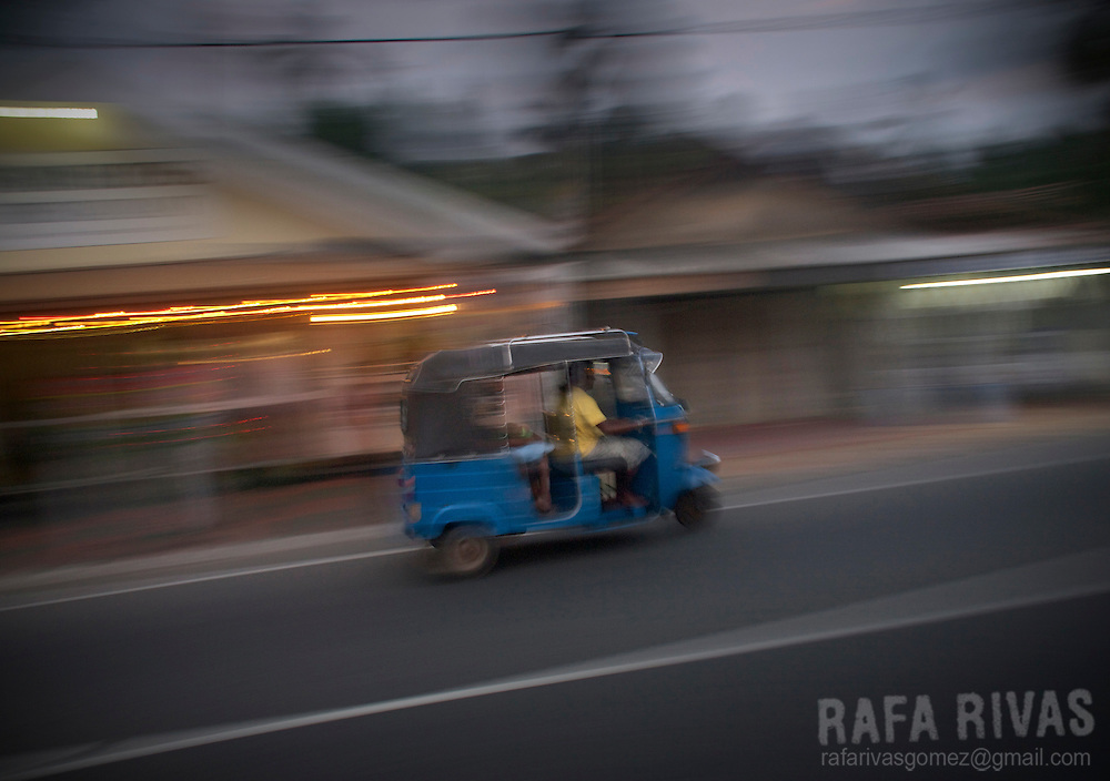 A tuc-tuc drives along the main road in Hikkaduwa, Sri Lanka, February 2011.