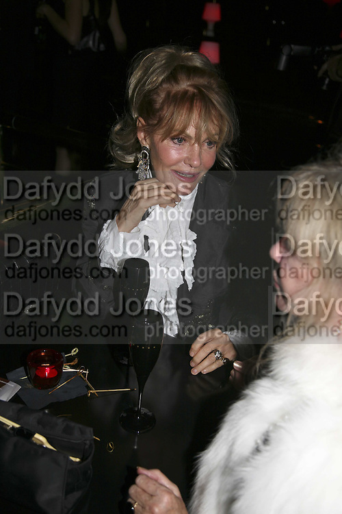 Pat Booth and Patti Boyd, Bazaar and Moet  Black, White and Gold party. Ronnie Scott's. Frith St. London. 16 november 2006. ONE TIME USE ONLY - DO NOT ARCHIVE  © Copyright Photograph by Dafydd Jones 66 Stockwell Park Rd. London SW9 0DA Tel 020 7733 0108 www.dafjones.com
