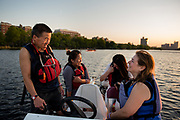 BDBF race director and Wellness Warriors head coach Peter Lew, of Newton, talks with Wellness Warriors co-president Erica Bernstein during practice on the Charles River near the MIT Pierce Boathouse in Cambridge, May 17, 2017.   [Wicked Local Photo/James Jesson]