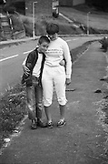 Neville and Girl by the Roadside, High Wycombe, UK, 1980s.