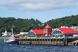 Cafes and Ee-Usk restaurant on North Pier in harbour at Oban , Argyll and Bute, Scotland, United Kingdom