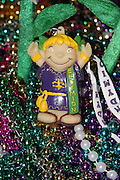 Mardi Gras doll and beads.