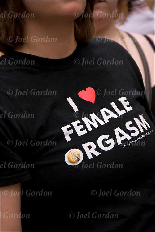 "Close up of lesbian wearing tee shirt ""I Love Female Orgasm""."