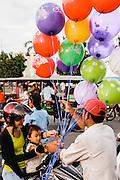 Balloon seller at park in front of Royal Palace, Phnom Penh