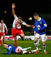 Picture by David Horn/Focus Images Ltd +44 7545 970036<br /> 25/01/2014<br /> Simon Heslop of Stevenage is fouled by Bryan Oviedo of Everton who has a suspected roken leg as a result during the The FA Cup match at the Lamex Stadium, Stevenage.