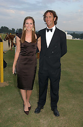 NINA VESTEY and JOHN PAUL CLARKIN at the Cowdray Gold Cup Golden Jubilee Ball held at Cowdray Park Polo Club, on 21st July 2006.<br /><br />NON EXCLUSIVE - WORLD RIGHTS
