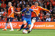 Matt Robinson of Luton Town (right) tackels Sammy Moore of AFC Wimbledon during the Sky Bet League 2 match at Kenilworth Road, Luton<br /> Picture by David Horn/Focus Images Ltd +44 7545 970036<br /> 16/08/2014
