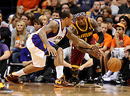 Nov. 09, 2012; Phoenix, AZ, USA; Phoenix Suns guard Shannon Brown (26) bats  the ball away from the Cleveland Cavaliers guard Daniel Gibson (1) during the second half at US Airways Center. The Suns defeated the Cavaliers 107-105. Mandatory Credit: Jennifer Stewart-US PRESSWIRE