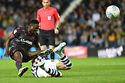 Reading defender Andy Yiadom (17)  tackles West Bromwich Albion midfielder (on loan from Benfica) Filip Krovinovic (7) during the EFL Sky Bet Championship match between West Bromwich Albion and Reading at The Hawthorns, West Bromwich, England on 21 August 2019.