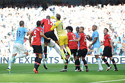 Manchester United's David De Gea punches the ball clear - Photo mandatory by-line: Dougie Allward/JMP - Tel: Mobile: 07966 386802 22/09/2013 - SPORT - FOOTBALL - City of Manchester Stadium - Manchester - Manchester City V Manchester United - Barclays Premier League