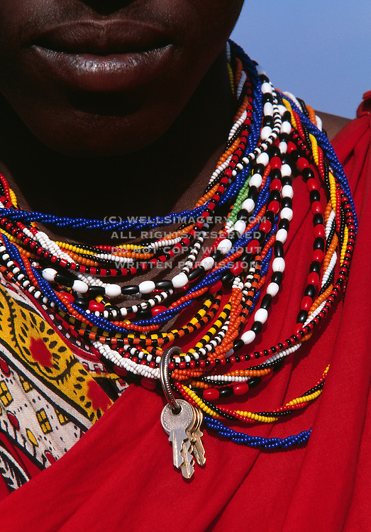 Image of a young male Masai Mara warrior wearing traditional clothes, Masai Mara National Reserve, Kenya, Africa, model released