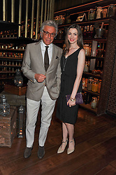 GIANCARLO GIAMMETTI and ANNE HATHAWAY at a dinner to celebrate the beginning of a unique partnership between The Naked Heart Foundation and W's Newest Hotel W St.Petersburg -The 'For Russia With Love' dinner was hosted by Sadie Frost and Natalia Vodianova at Spice Market restaurant, W London, Leicester Square, London on 2nd June 2011.