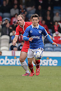 Conor Chaplin holds off Keith Lowe during the Sky Bet League 2 match between Portsmouth and York City at Fratton Park, Portsmouth, England on 2 May 2015. Photo by Simon Davies.