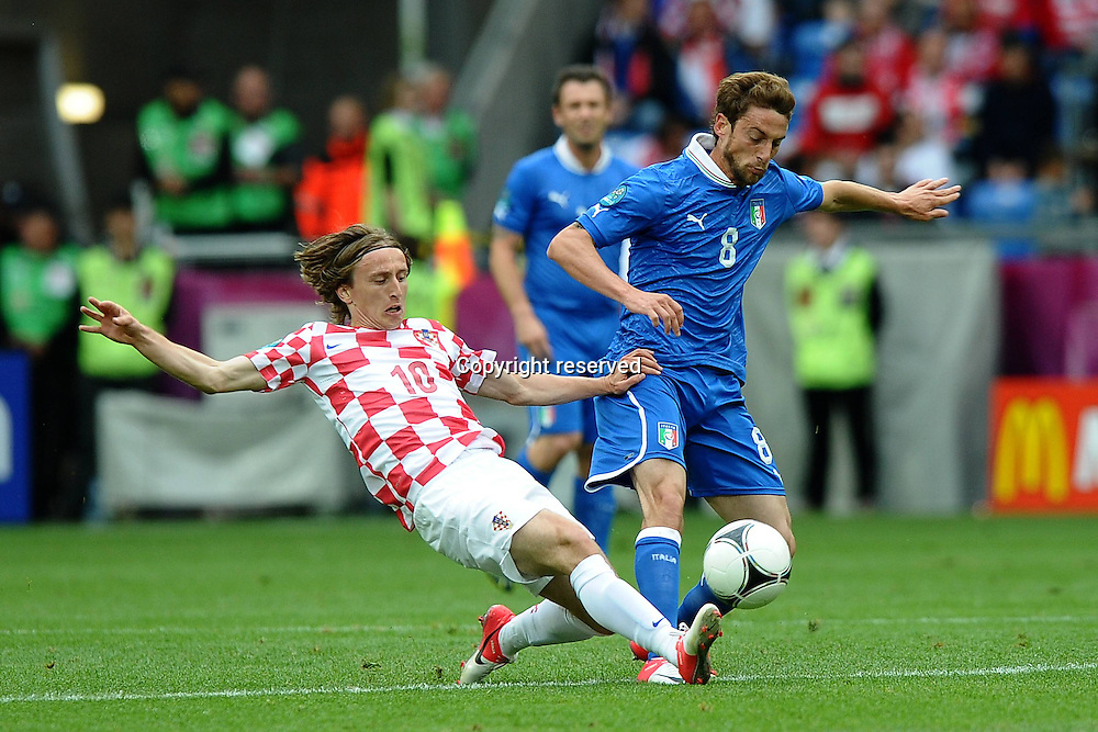 14.06.2012. Poznan, Poland. EURO 2012, FOOTBALL EUROPEAN CHAMPIONSHIP, Italy versus Croatia. Luka Modric Croatia left Claudio Marchisio Italy right