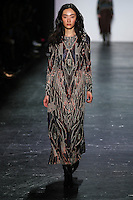Ji Young Park walks the runway wearing Vivienne Tam Fall 2016 during New York Fashion Week on February 15, 2016