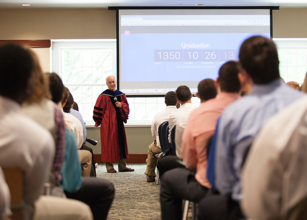 Hugh Sherman, dean of the College of Business, shows freshmen how many days of class they have left before graduation during the College of Business Freshman Convocation in Nelson Commons, on Saturday, August 22, 2015. Photo by Kaitlin Owens