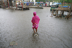 June 17, 2017 - Dhaka, Bangladesh - A Bangladeshi woman walks on the flooded street at Purbo Dholaipar, Dhaka, Bangladesh, June 17, 2017. Encroachment of canals is contributing to the continual water logging in the area. (Credit Image: © Suvra Kanti Das via ZUMA Wire)