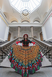 Spectacular costumes from a classic children&rsquo;s book, a sci-fi ballet and the Mexican underworld are showcased by University of Edinburgh students. <br /> <br /> The outfits have been designed by Performance Costume students for a jaw-dropping theatrical show. The Performance Costume Show takes place in Edinburgh College of Art&rsquo;s Sculpture Court on 18 and 19 May.<br /> <br /> Children&rsquo;s book favourite The Tiger Who Came to Tea is brought to life by student Gracie Martin&rsquo;s art deco design. She has imagined the tiger as a 1920s gangster wearing a pinstripe suit and tie.<br /> <br /> Yan Smiley has created characters for a sci-fi ballet set in 17th century Scotland. The outfit is inspired by stained glass windows and rugged Highland landscapes.<br /> <br /> Ellie Finch has made a dazzling outfit for Maid Marian, set in contemporary Mexico. The vibrant outfit highlights iconography linked to the country&rsquo;s drug cartels, with a headdress of poppies and needles and a kaleidoscopic skirt covered in prints of machine guns and cannabis leaves. <br /> <br /> Irvine Welsh&rsquo;s novel Marabou Stork Nightmares was the focus of Dayna Ali&rsquo;s surreal designs. She has created the Marabou Stork &ndash; half bird, half football hooligan. He has a large head and beak and wears fluorescent &lsquo;90s sportswear with a specially made Marabou logo.<br /> <br /> Zoe Frewin has created costumes from Disney Pixar&rsquo;s animation, A Bug&rsquo;s Life. Inspired by George Orwell&rsquo;s 1984, the insects wear uniforms and their colour denotes their class in society.<br /> <br /> Pictured: Gracie Martin wearing Maid Marion costume designed by Ellie Finch