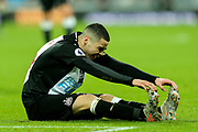 Miguel Almiron (#24) of Newcastle United stretches following a tackle that leaves him on the floor during the Premier League match between Newcastle United and Crystal Palace at St. James's Park, Newcastle, England on 21 December 2019.