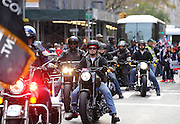 "Harley-Davidson employees and veterans ride in the 2015 America's Parade on Veterans Day, Wednesday, Nov. 11, 2015, in New York, to announce the extension of ""Operation Personal Freedom: Ride Free,"" free Riding Academy motorcycle training to all active-duty military and veterans. (Photo by Diane Bondareff/AP Images for Harley-Davidson)"