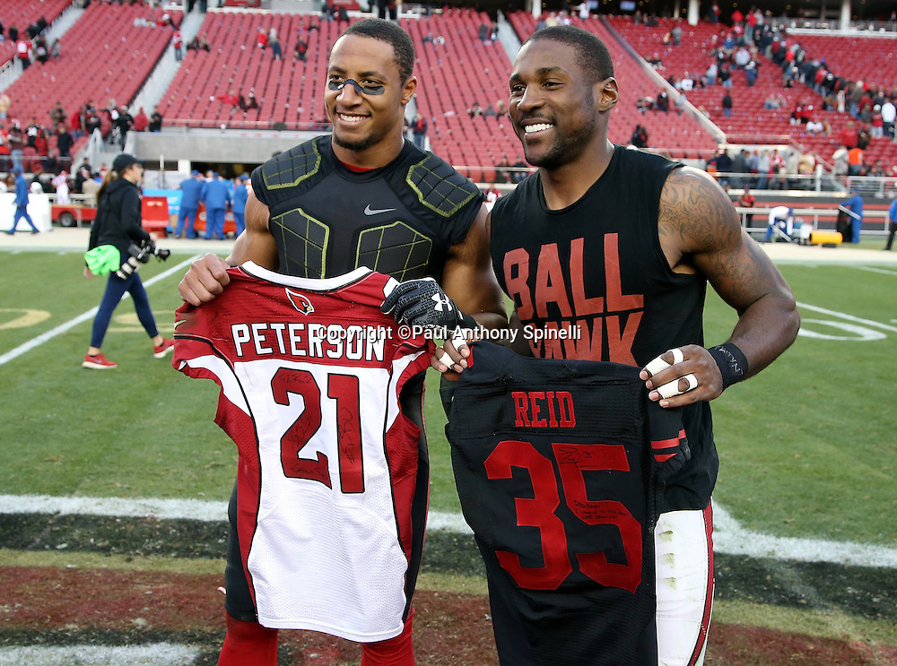 (L-R) San Francisco 49ers free safety Eric Reid (35) and Arizona Cardinals cornerback Patrick Peterson (21) pose for a postgame photograph after trading jerseys after the 2015 week 12 regular season NFL football game against the San Francisco 49ers on Sunday, Nov. 29, 2015 in Santa Clara, Calif. The Cardinals won the game 19-13. (©Paul Anthony Spinelli)