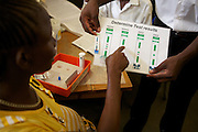 Margaret Akitela having an HIV test as part of her check up at the Maternal Child Health Clinic, Lodwar District Hospital, Turkana, northern Kenya. The results are very quick and she is HIV negative.